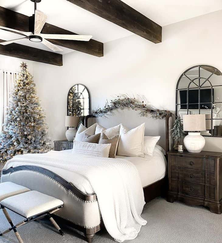 Christmas decor in master bedroom with brown furniture and wood beams