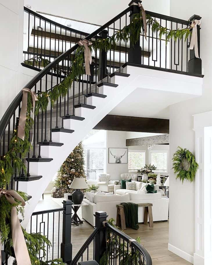 Christmas staircase decor with pre-lit green garland