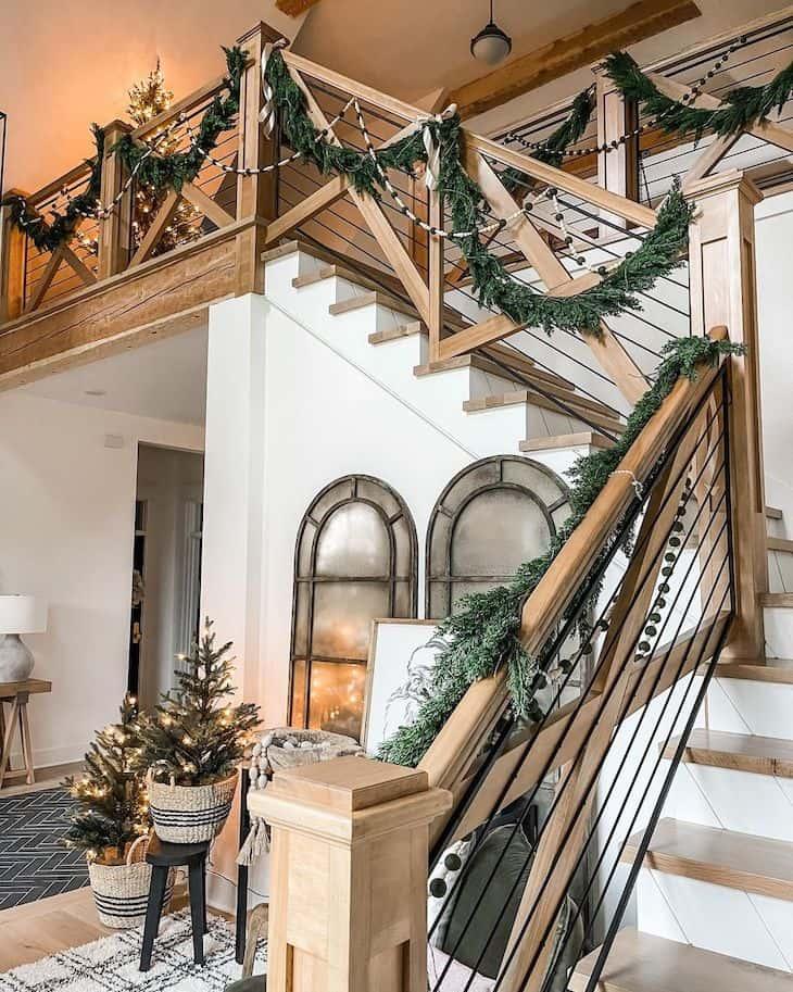 White oak staircase railings with modern farmhouse Christmas decor