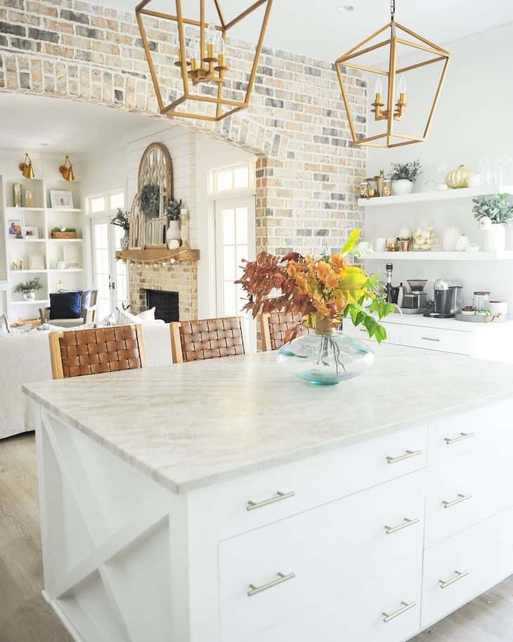 White kitchen island with drawers and centerpiece