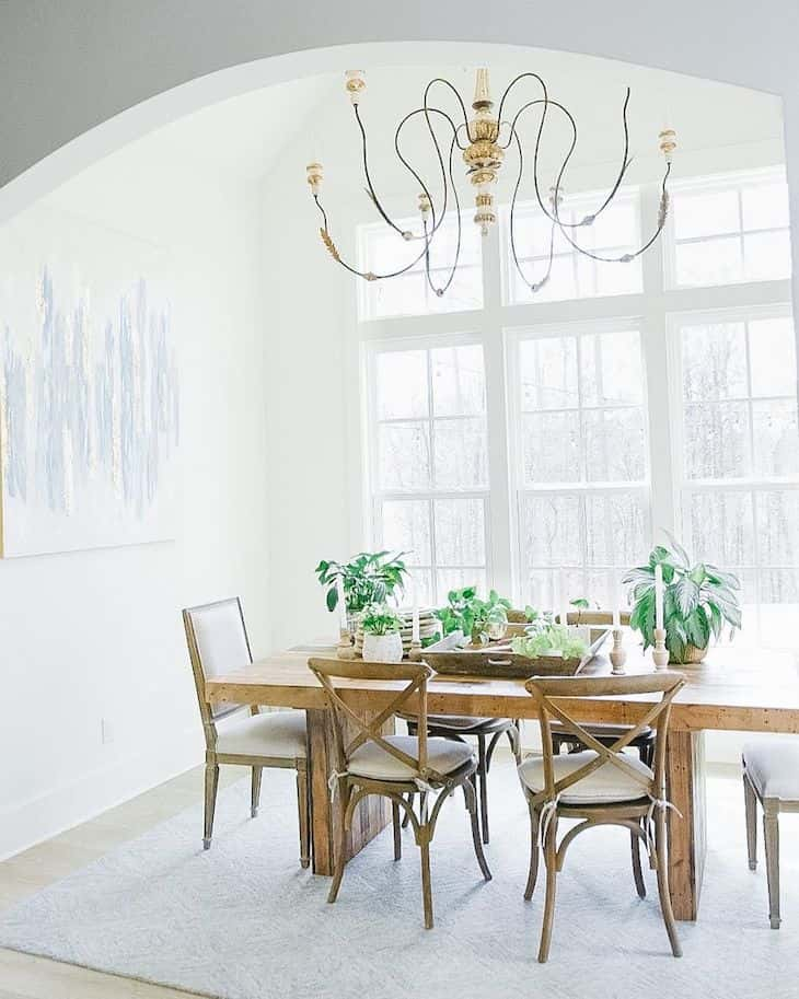 Dining room with different wooden chairs