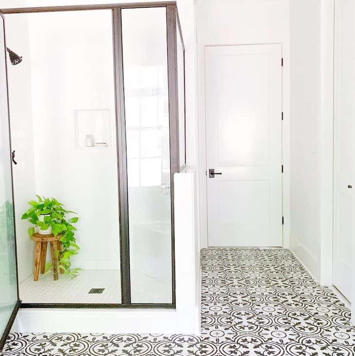 Shower in master bathroom with print tiles