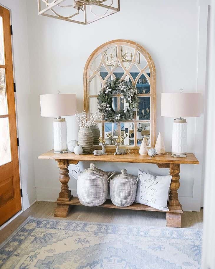 farmhouse entryway with two leg console table in wood finish and two table lamps