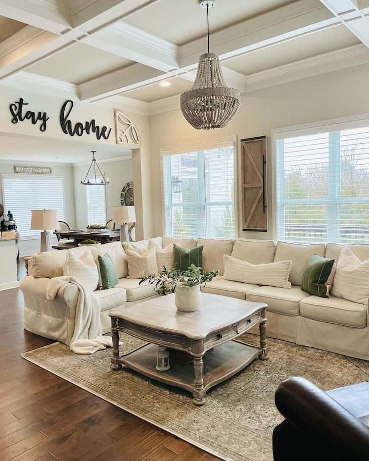 Neutral farmhouse living room with grid beam ceiling and square farmhouse coffee table