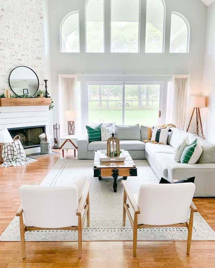Living room with corner fireplace in shiplap and big windows