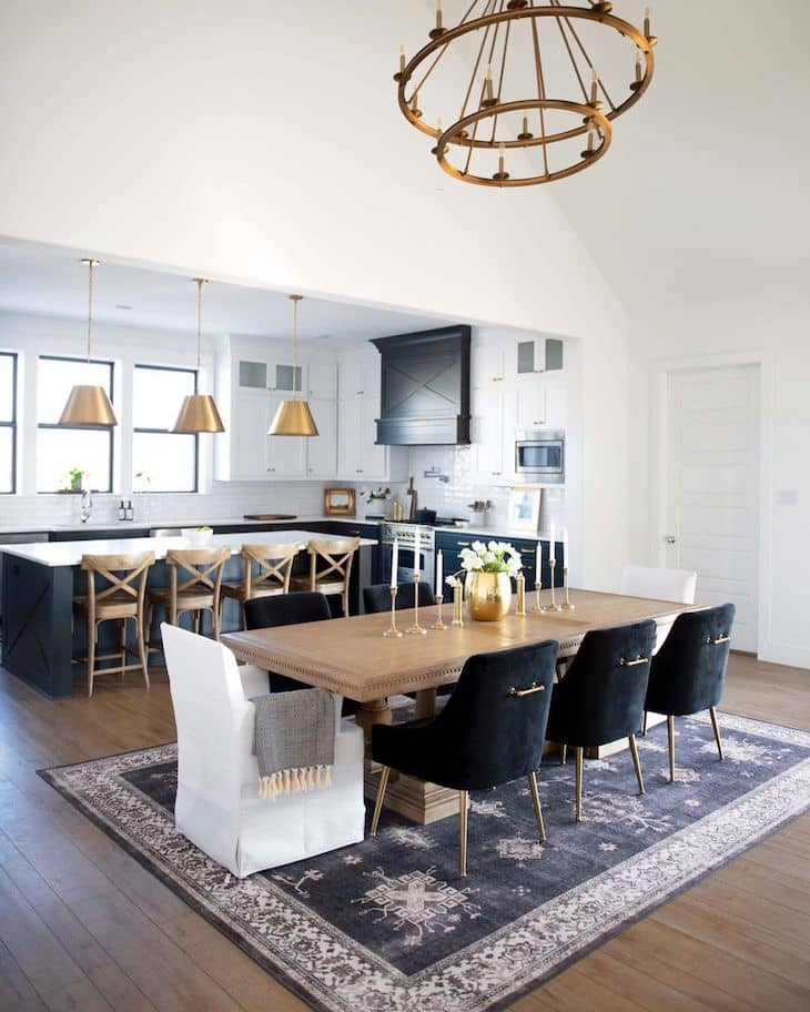 Dining room with 8 seater wood dining table, velvet chairs and rug