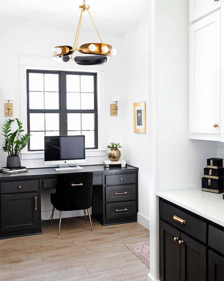 Black and white home office off the kitchen