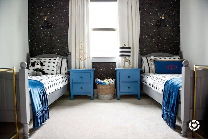 Shared kids room for boys with stars and blue accents