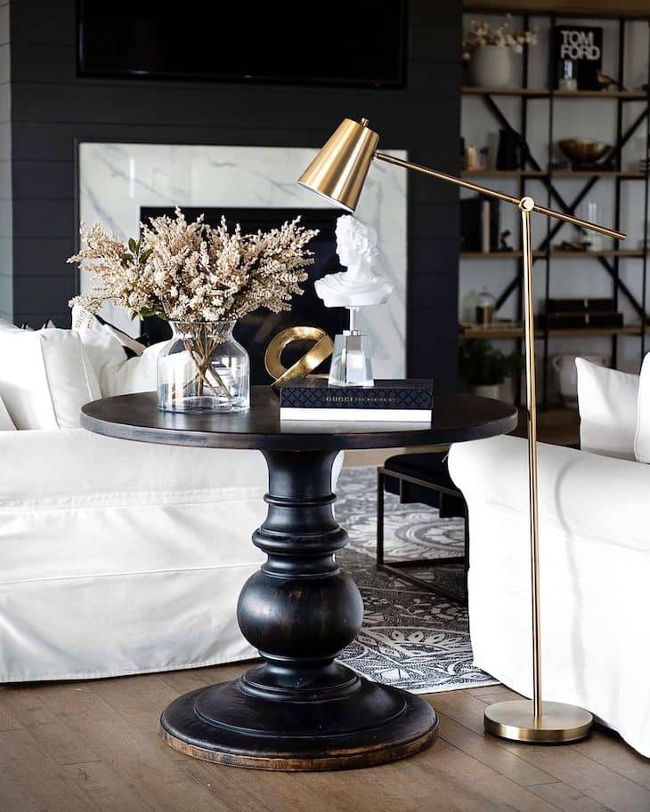 Black round end table with decor