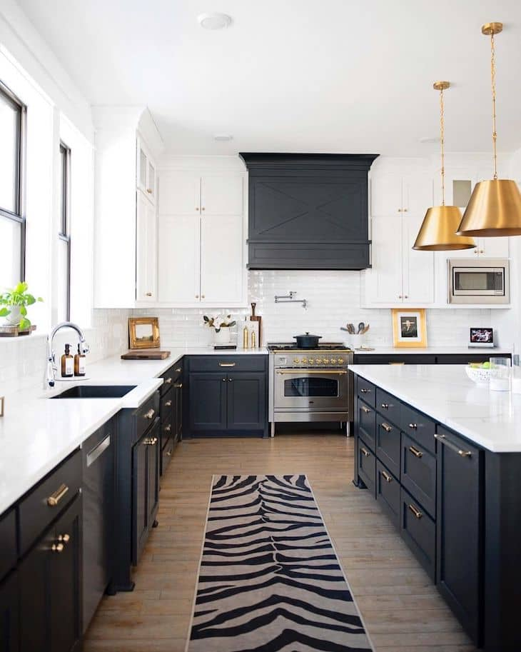 Modern farmhouse kitchen with white upper and black lower cabinets