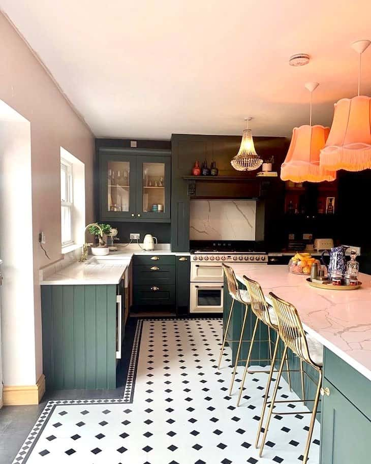 Deep forest green kitchen with marble backsplash and marble counter