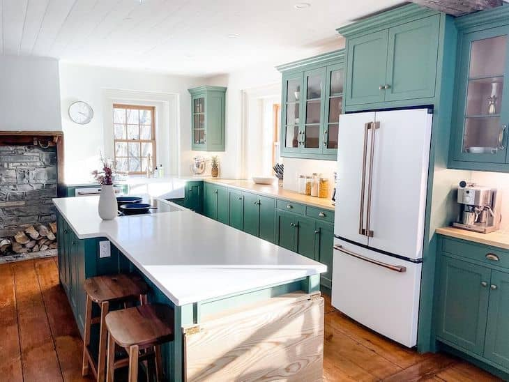 Modern farmhouse green kitchen with rustic stools