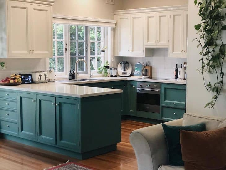 Kitchen with green lower cabinets and white upper cabinets