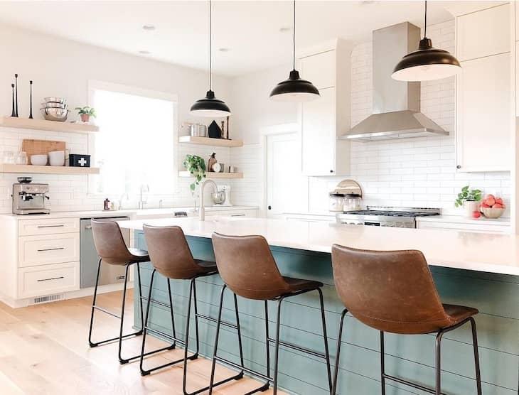 Open shelf kitchen with green shiplap island