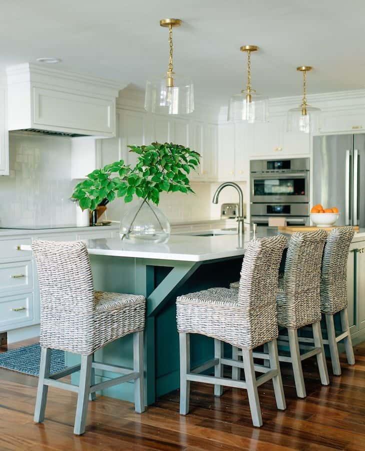 White kitchen with green kitchen island