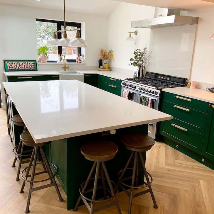 Bold shade of green kitchen, with no upper cabinets.
