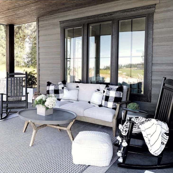 Patio decor with wood furniture and black rocking chairs