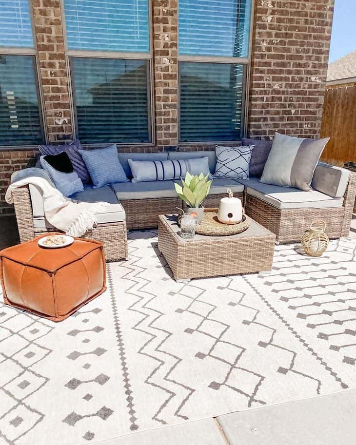 Patio decor with wicker furniture and boho pouf