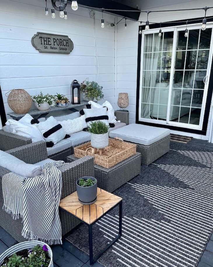 Farmhouse patio decor with grey outdoor rug