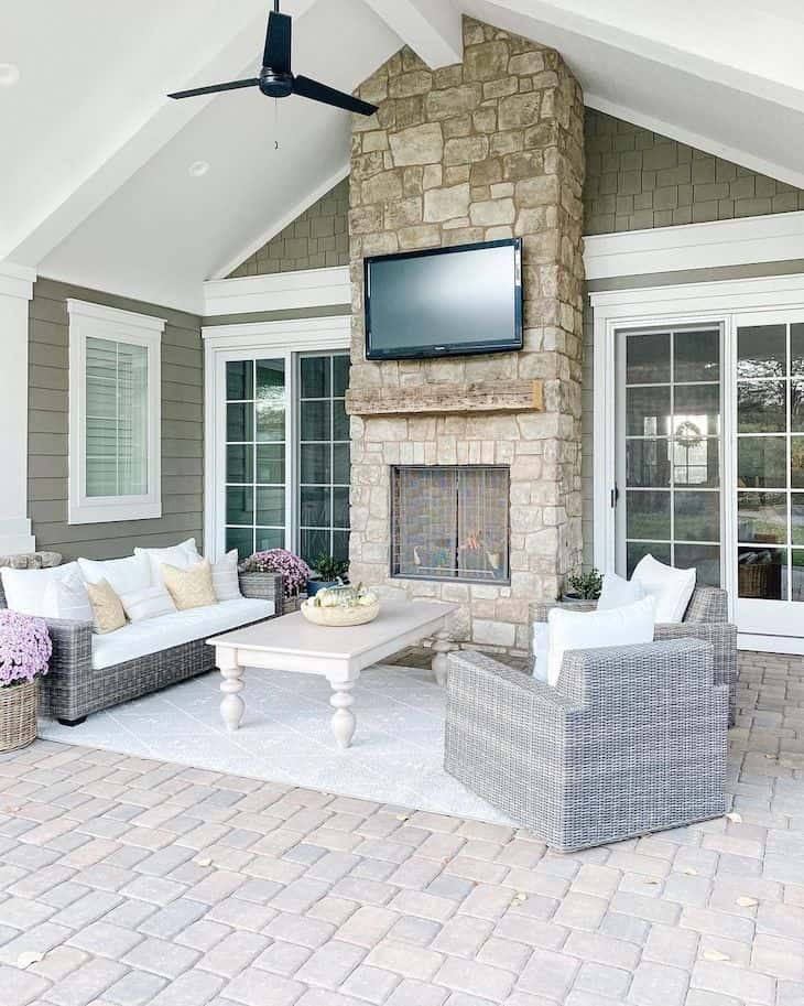 Outdoor living room with fireplace and wicker furniture