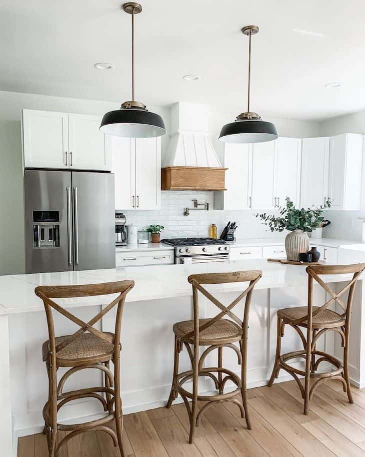 Farmhouse style bar stools with x back in a white kitchen