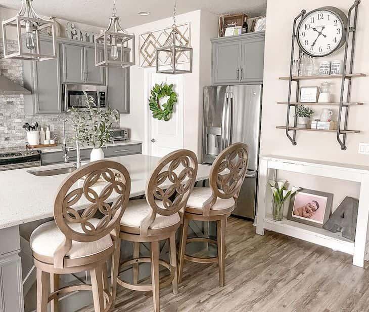 Wood swivel bar stools in grey farmhouse kitchen