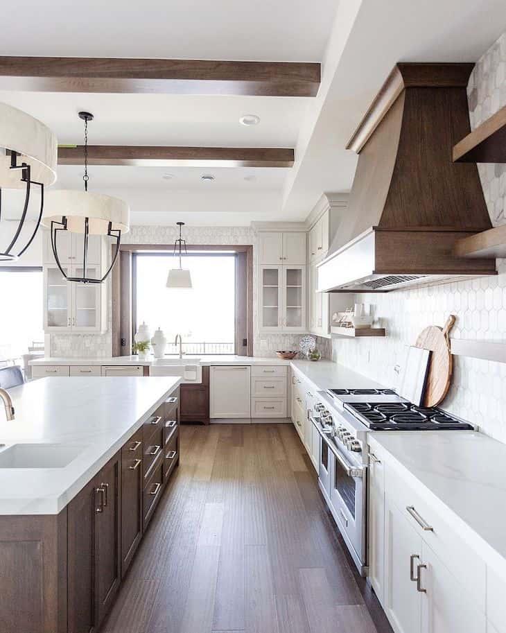 White farmhouse kitchen cabinets white deep wood tone kitchen island and wood range hood