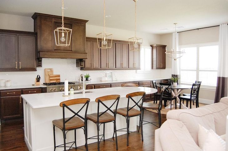 Deep wood kitchen cabinets with white island