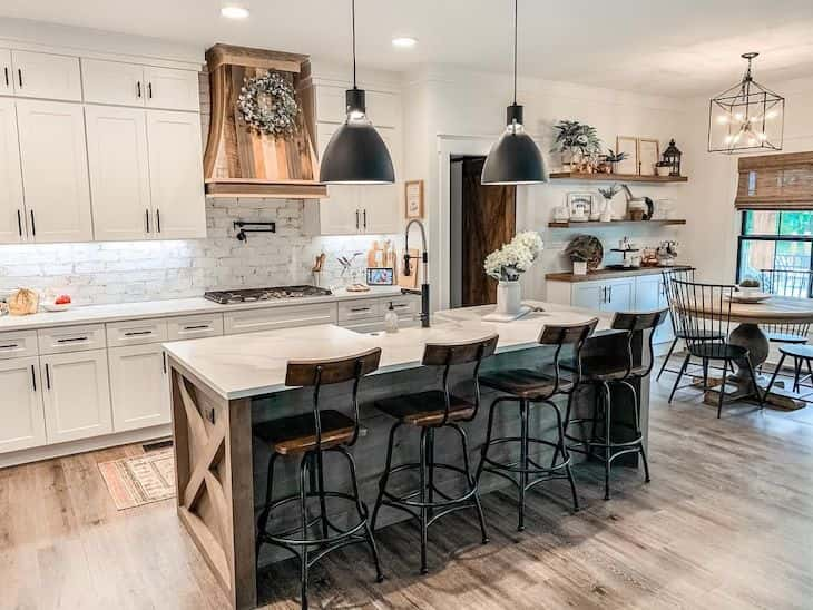White farmhouse kitchen with wood island and black accents