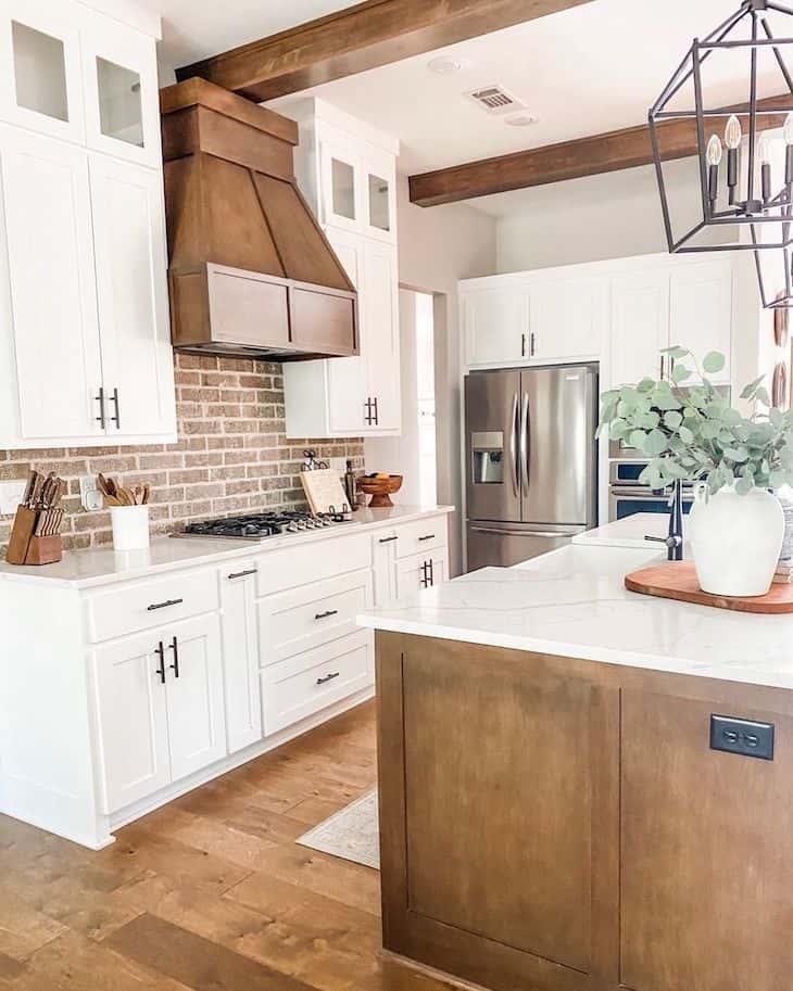 White and wood kitchen with red brick backsplash