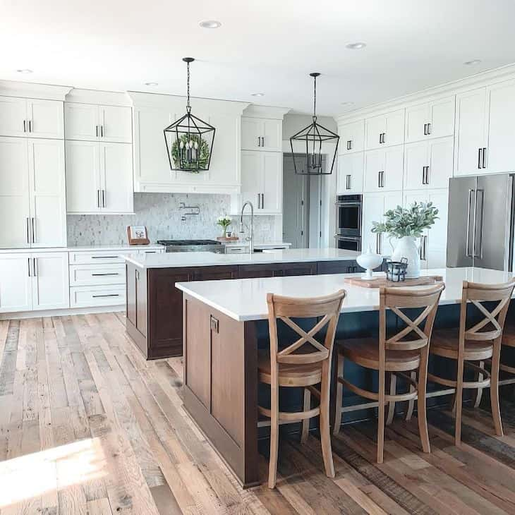 White and wood kitchen with double island