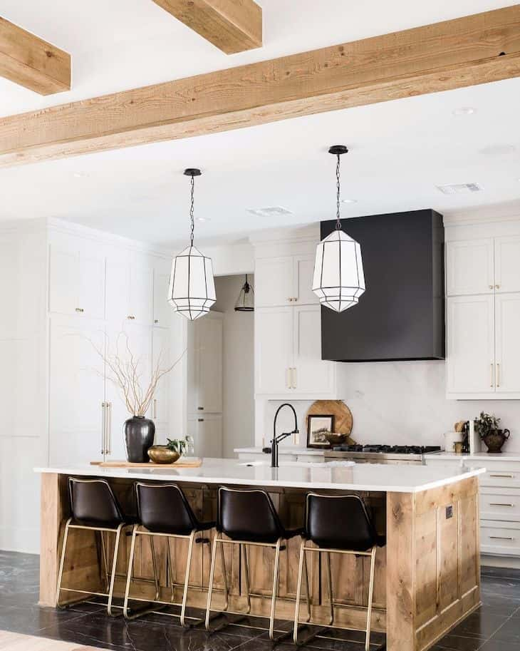 Modern farmhouse kitchen with white cabinets and reclaimed wood kitchen island