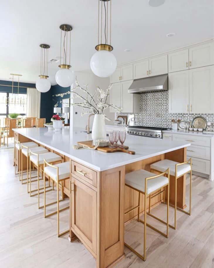 White oak kitchen island and white kitchen cabinets