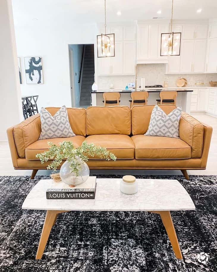 Modern living room with light leather couch