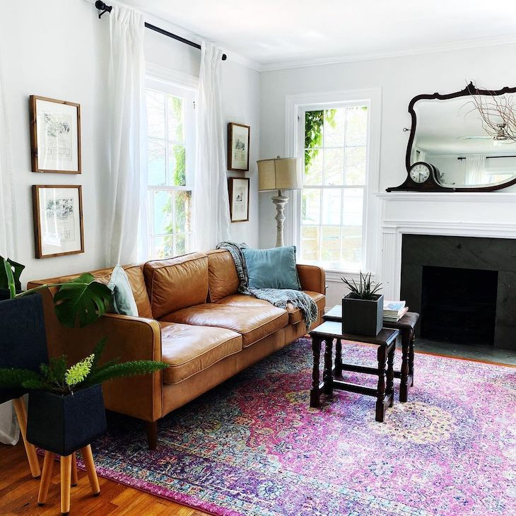 Eclectic living room with pink carpet