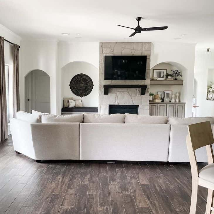 Alabaster white walls and grey stone fireplace