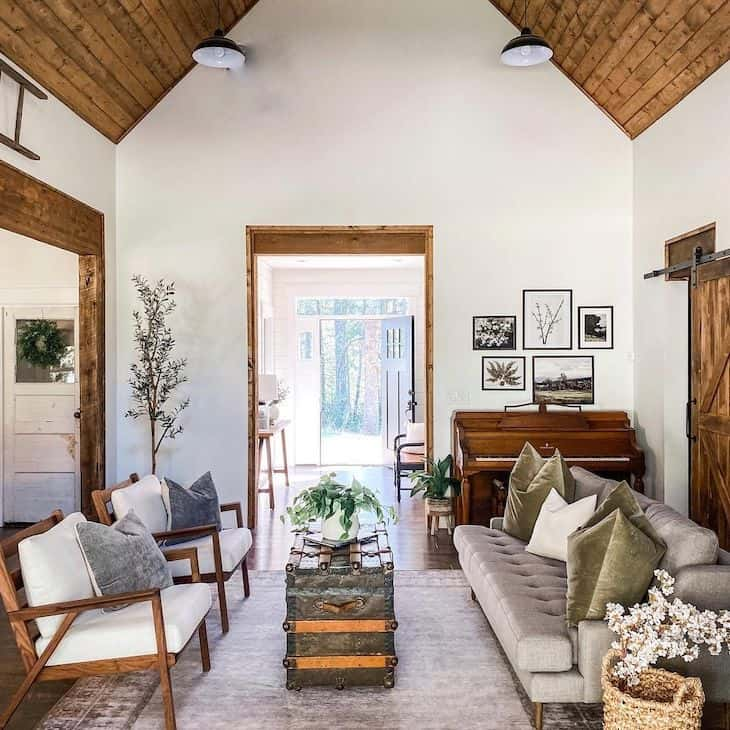 Sherwin Williams Alabaster white walls and stained wood ceilings in living room