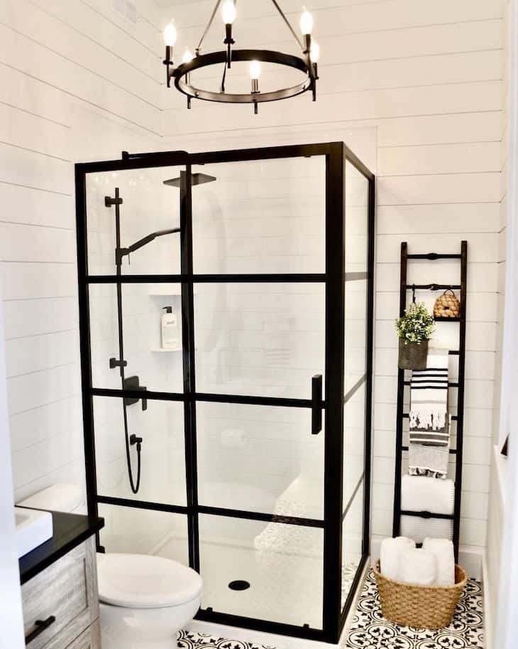 White subway tile for shower with shiplap walls and black shower glass frame