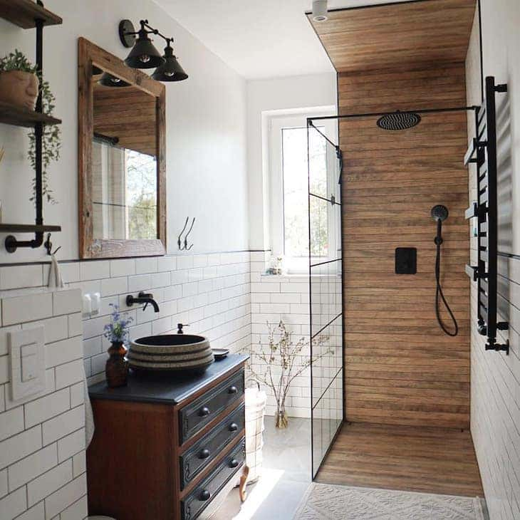 Wood looking shower tile in a rustic farmhouse bathroom