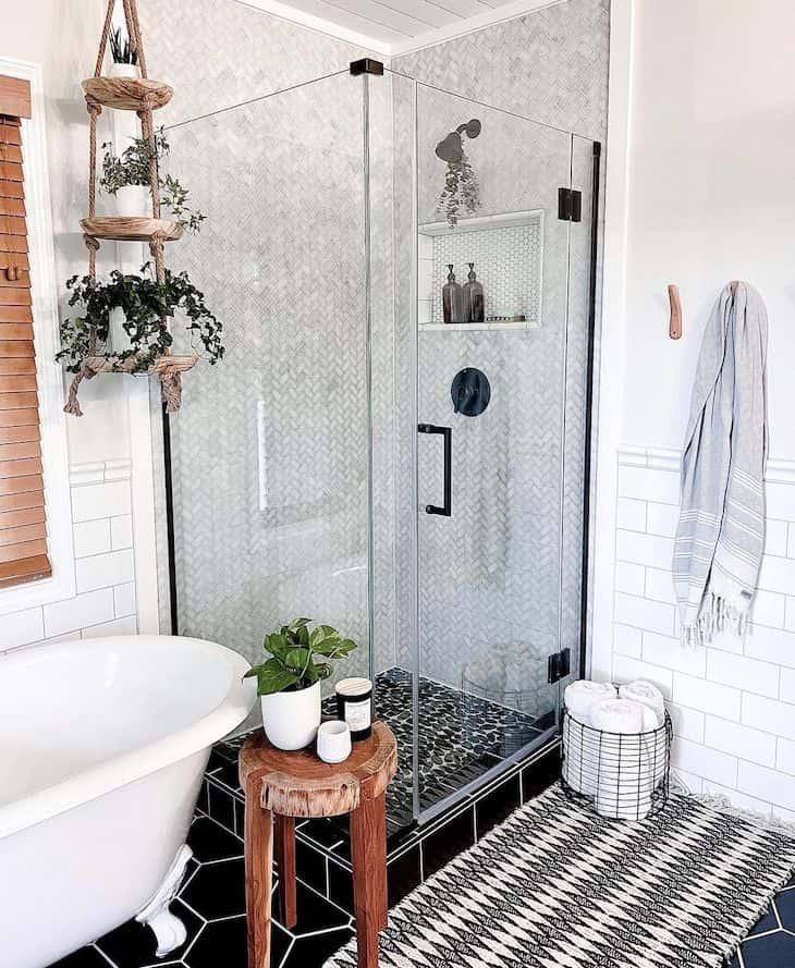 Small herringbone shower tile with black shower floor tile