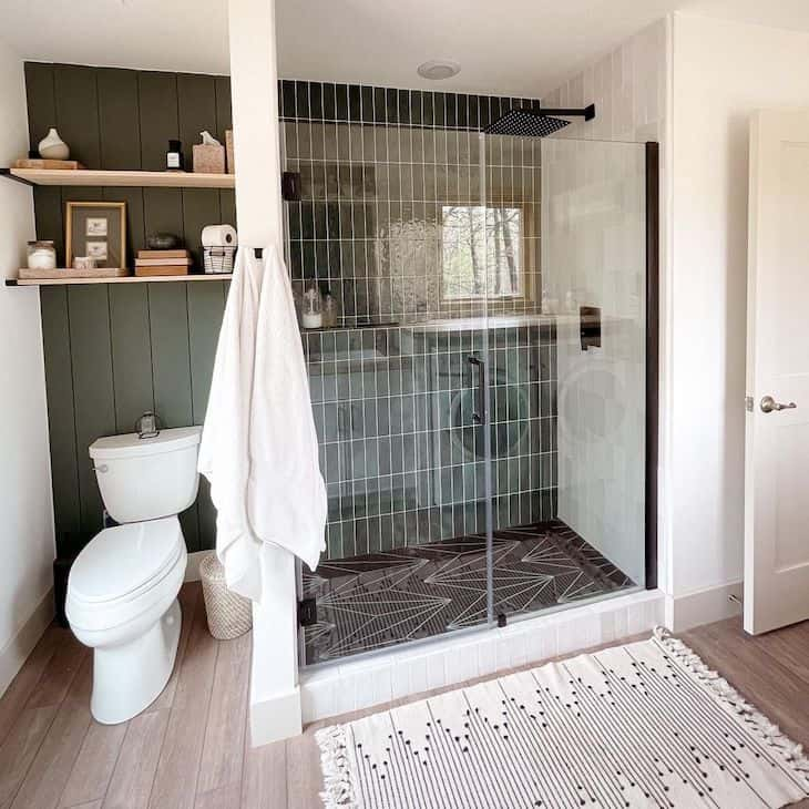 Forest green shower tile in farmhouse bathroom