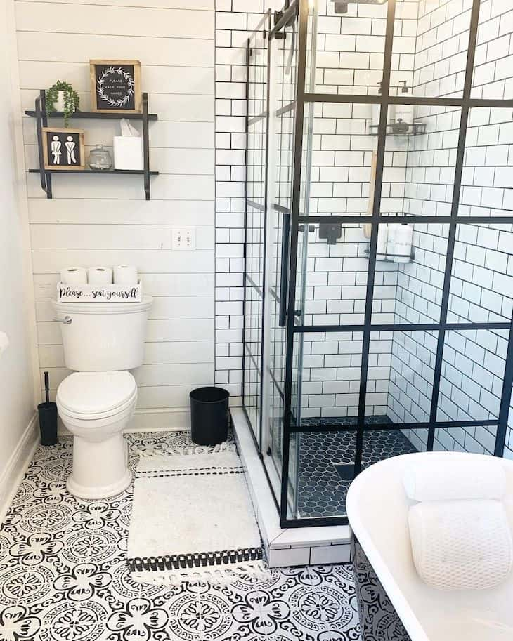 Shower subway tile with black grout and honeycomb shower floor tile