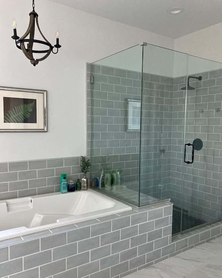 Grey shower tile in subway pattern with in-shower bench