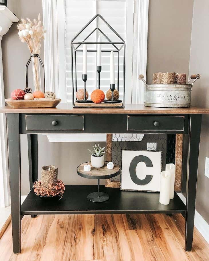 Black entryway table with fall decor
